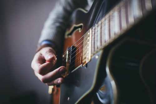 deaf person playing a guitar