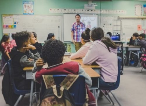 deaf students - a teacher in front of a class of students
