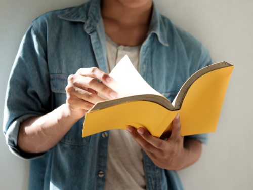 A man reading: 5 new year's resolutions for deaf people