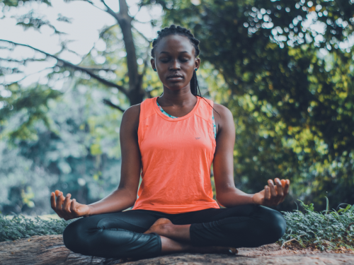 woman meditating: new year's resolutions for deaf people