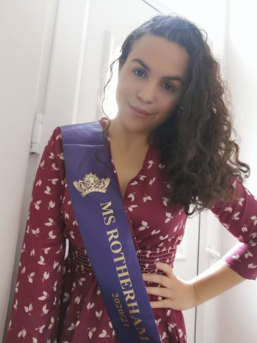 Deaf Pageant Ashleigh in a purple sash